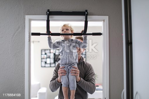 a Toddler playing on an exercise mat at home.