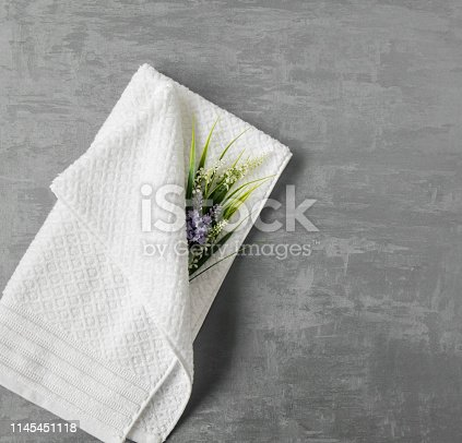 1164403347 istock photo a towel on gray background 1145451118