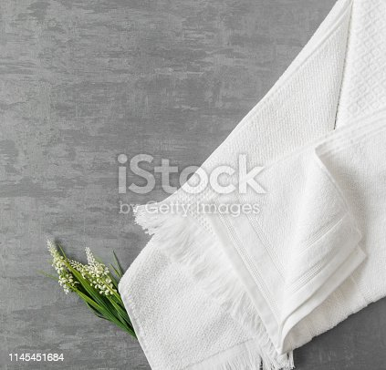 1164403347 istock photo a towel on gray background 1145451684
