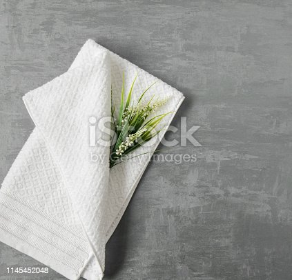 1164403347 istock photo a towel on gray background 1145452048