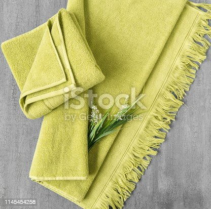 1164403347 istock photo a towel on gray background 1145454258
