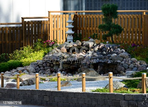 istock a traditional Japanese garden at the entrance to a supermarket car park in Järvenpää, Finland 1276847216