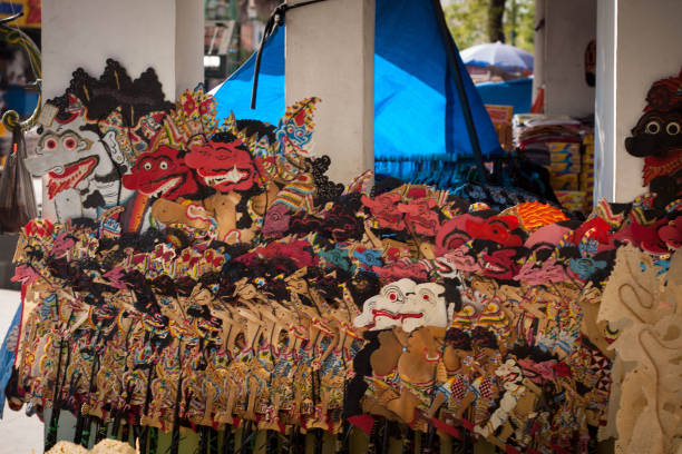 a traditional wayang from indonesia java on the market store malioboro jogja yogyakarta indonesia - wayang kulit stock photos and pictures