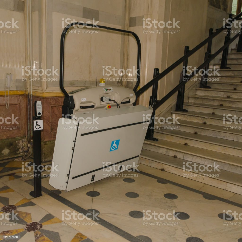 a transition to the stairs lift for disabled wheelchair users stock photo