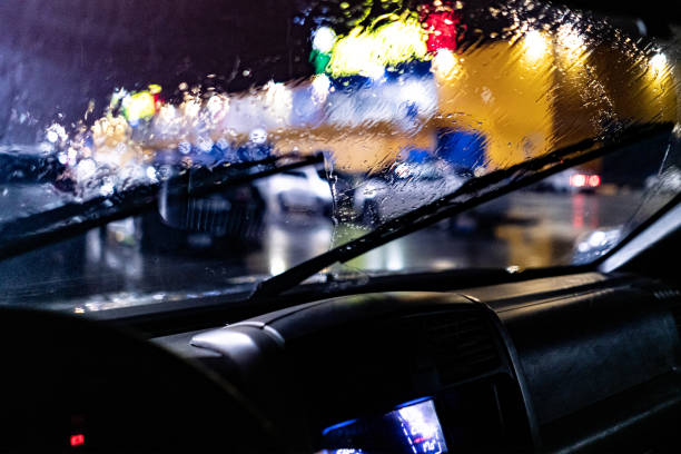 a view from inside the car of the windscreen wiper cleaning during night heavy rain stock photo
