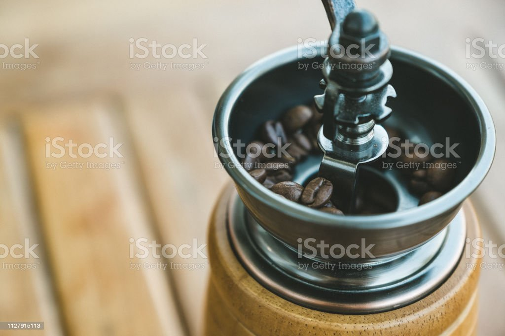 Closeup image of a vintage wooden coffee grinder