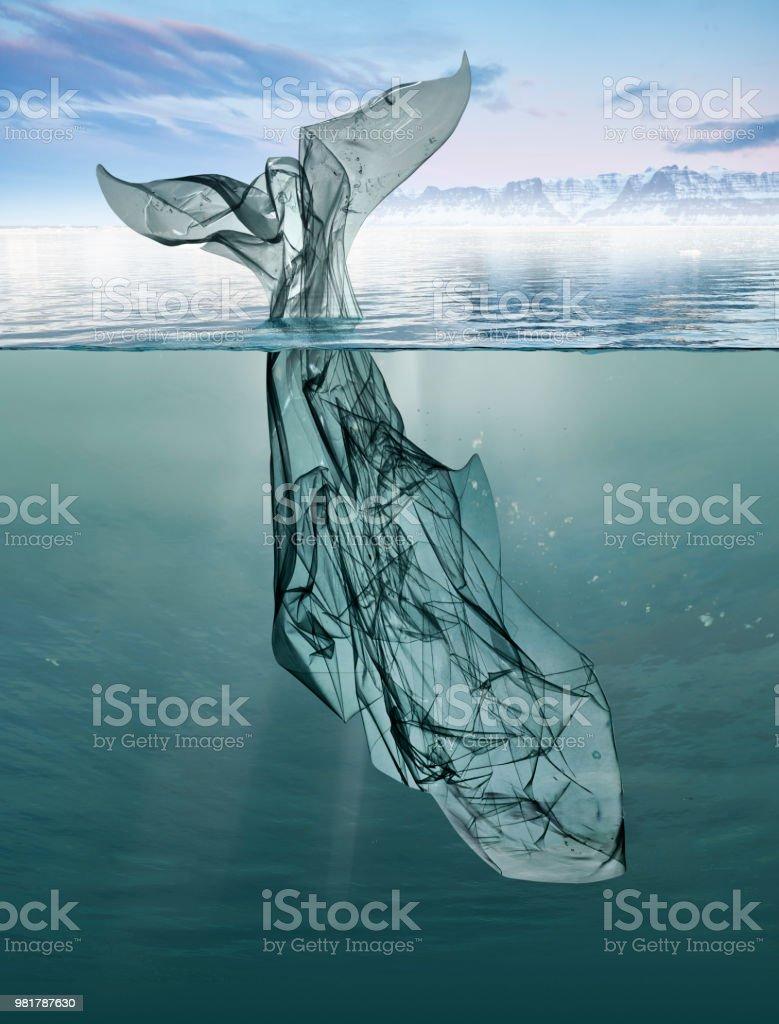 ein Wal Müll Plastik im Meer schwimmen. – Foto