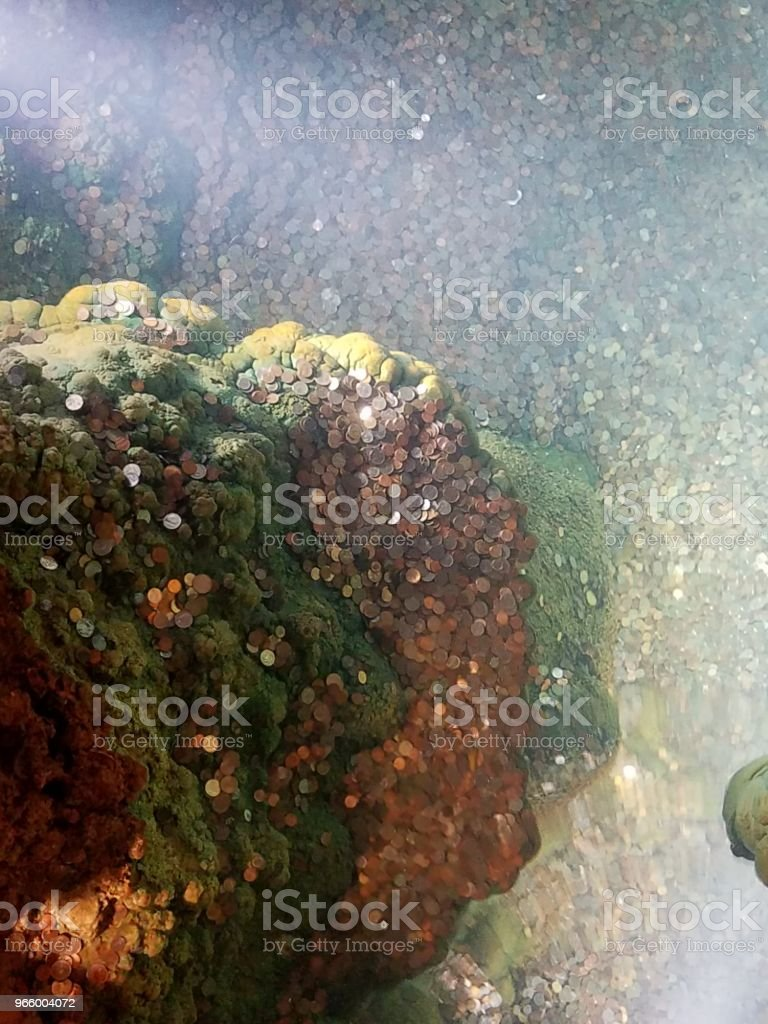 a wishing well in cave or cavern with coins - Royalty-free Cave Stock Photo
