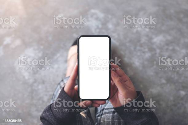 A woman holding black mobile phone with blank desktop screen while picture id1138089456?b=1&k=6&m=1138089456&s=612x612&h=c rx7k vfder2fr2pzq0m3 ksrejtdvgtsorzr51cko=