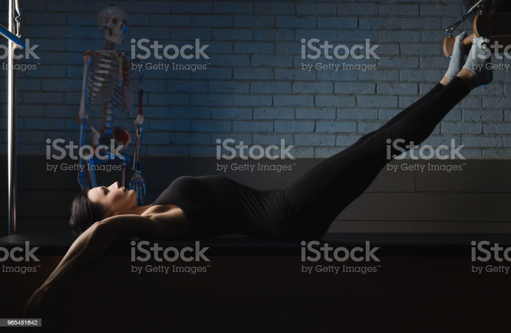 a woman is engaged in Pilates. fitness and sports royalty-free stock photo