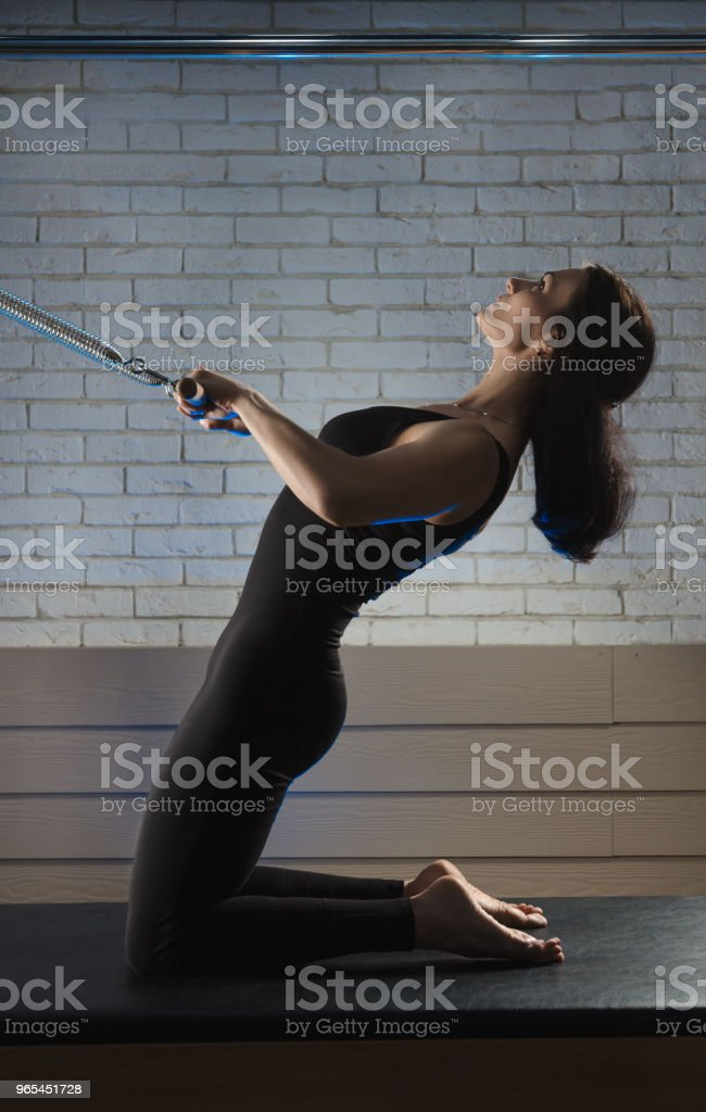a woman is engaged in Pilates. fitness and sports zbiór zdjęć royalty-free