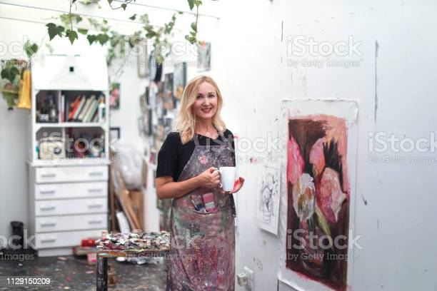 A woman painting in her art studio at home picture id1129150209?b=1&k=6&m=1129150209&s=612x612&h=xqalkmrp3x0cfs1dawi0mzsvon3 i9fnqjvmdehrbyq=