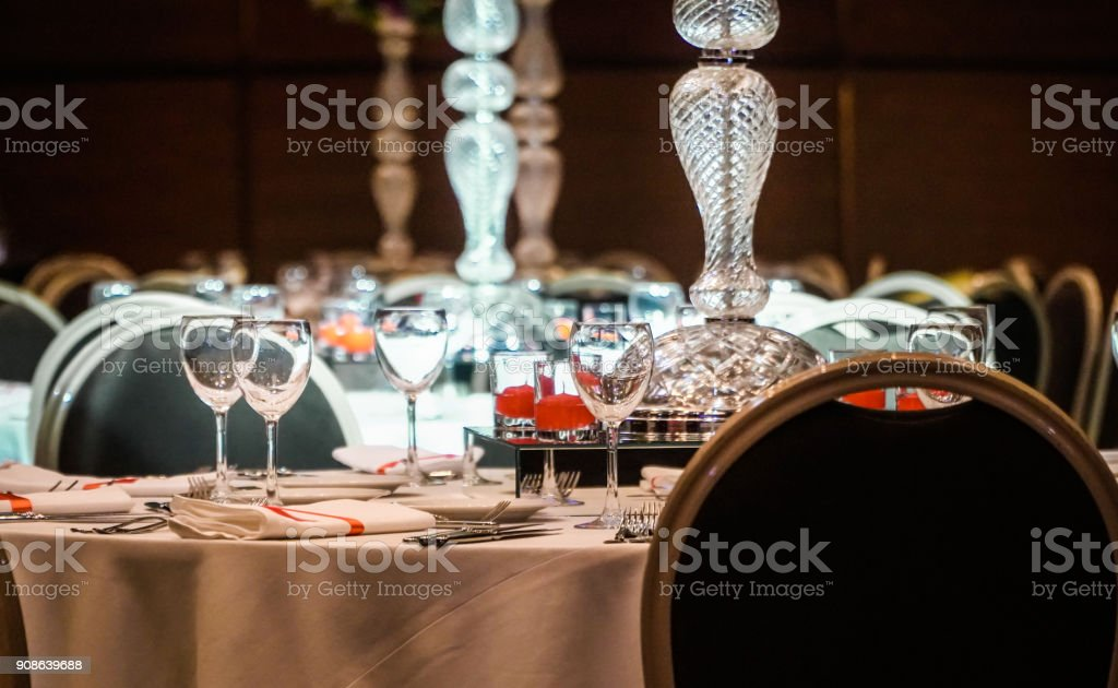 a wonderfully designed wedding room and dining tables stock photo