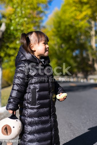 a young girl on the country road