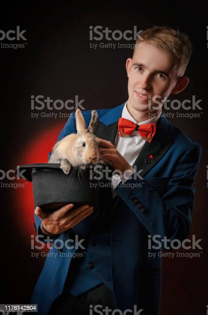 A young guy magician illusionist holding a hat with a rabbit picture id1176142804?b=1&k=6&m=1176142804&s=612x612&h=k1yccvlhmmiijyvhqltyv9vlt9ahjqkqk2hvcuwbhec=