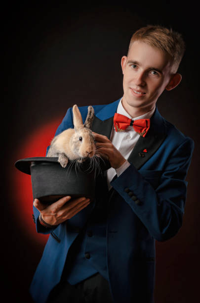 A young guy magician illusionist holding a hat with a rabbit picture id1176142804?b=1&k=6&m=1176142804&s=612x612&w=0&h=dxoal88sxct1hatwc7lis39fgabr7jxoehsq37pr8ag=
