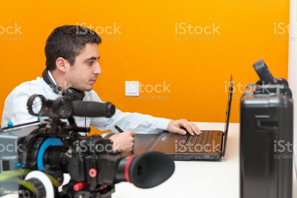 a young man designer using graphics tablet for video editing stock photo