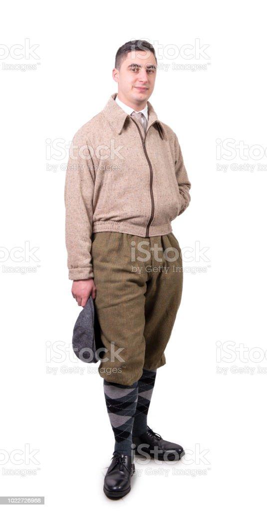 Vintage Kleding.Een Jonge Man In Vintage Kleding Met Hoed 1930stijl Op Wit Stockfoto