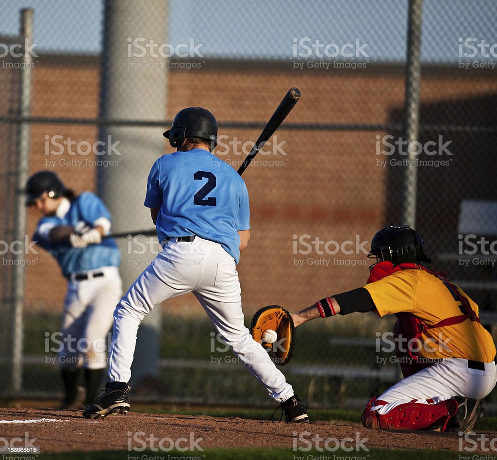 a young man is up for bat in baseball stock photo