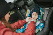 a young married couple with a child cares about safe driving