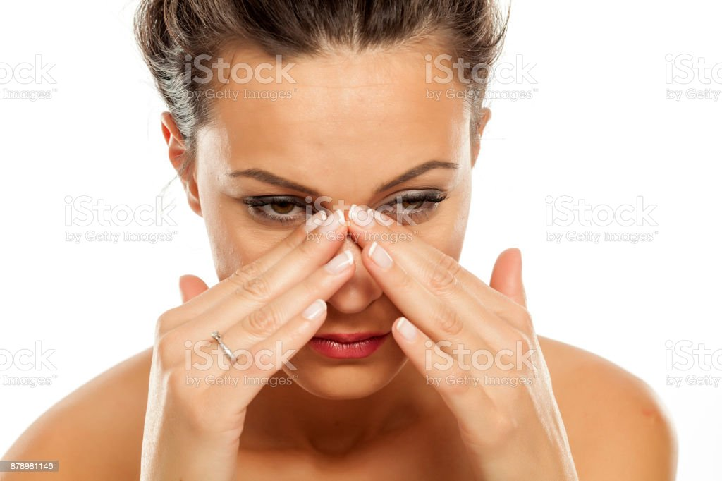 a young woman has pain in the sinuses stock photo
