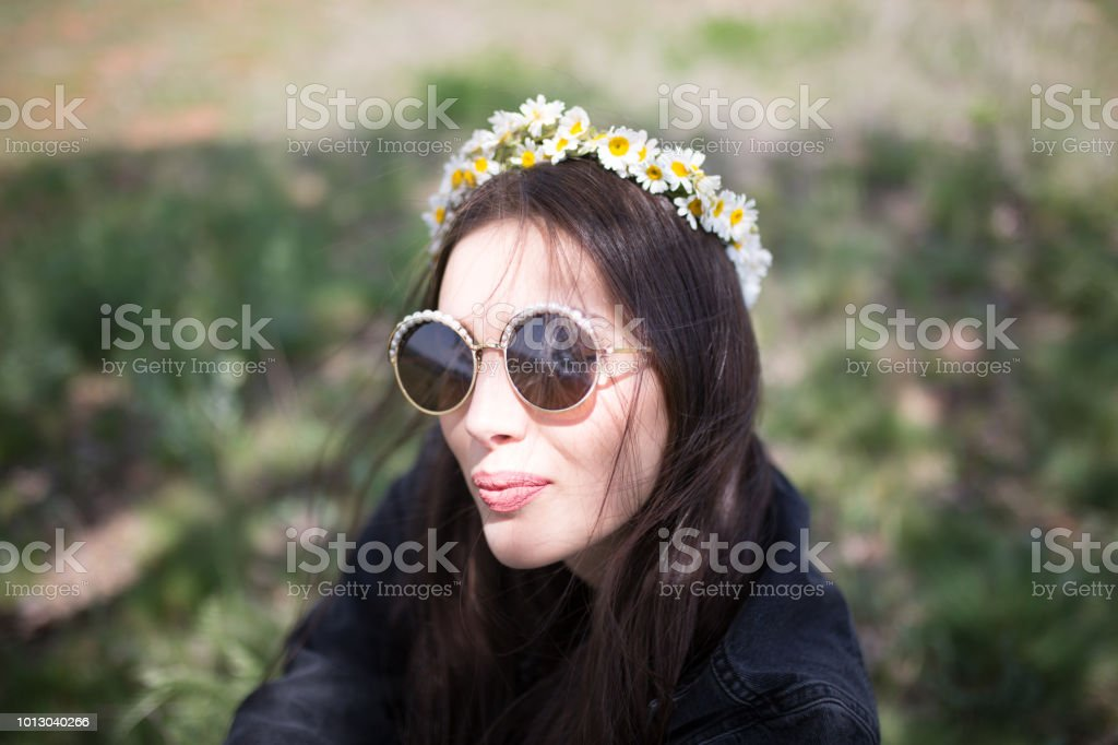 a young woman in the spring stock photo