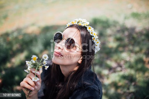 istock a young woman in the spring 1018192982