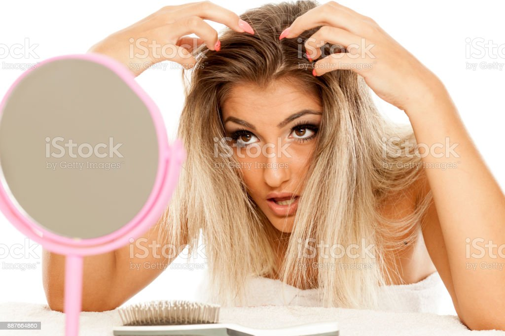 a young woman is worried about her hair stock photo