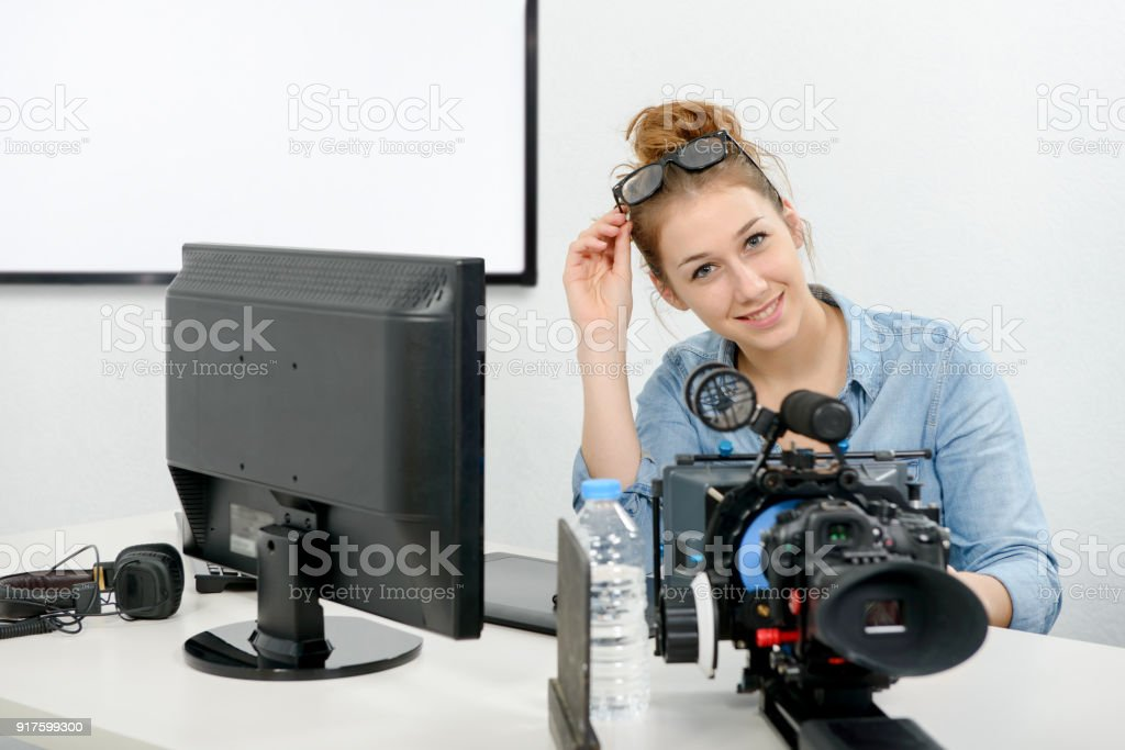 a young woman using computer for video editing stock photo