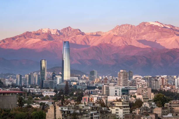 Aaerial view of Santiago skyline at sunset with Costanera skyscraper and Andes Mountains - Santiago, Chile stock photo