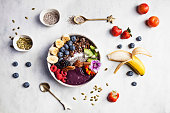 istock Açai bowl with fresh fruits for breakfast with banana, blueberries, blackberries, strawberries, kiwi, nuts and seeds 1284922389