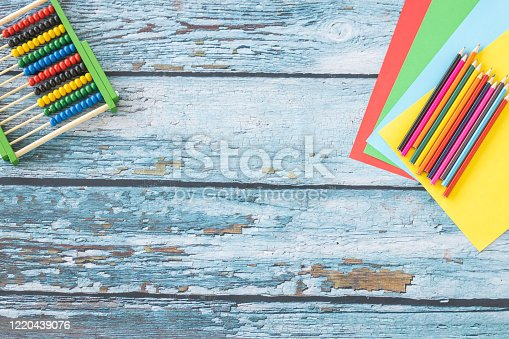 925244914 istock photo Abacus and colored pencils 1220439076