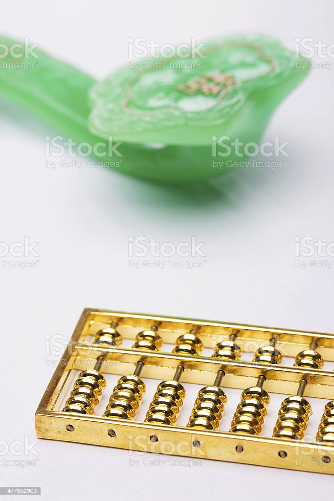 abacus and jade ruyi with background royalty-free stock photo