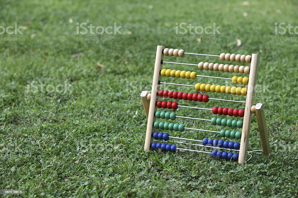 Abacus Wooden abacus on grass. Abacus Stock Photo