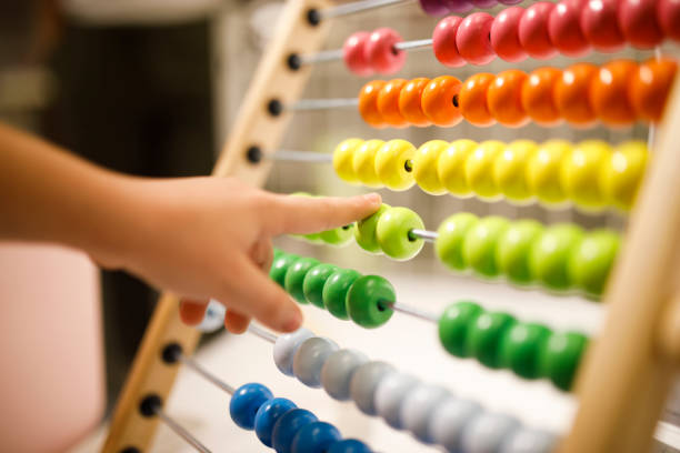Abacus Small fingers on the colorful abacus abacus stock pictures, royalty-free photos & images