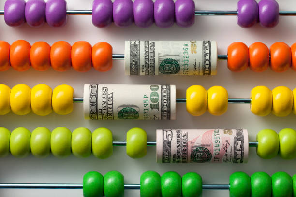 Abacus with rolls of dollar banknotes - foto stock