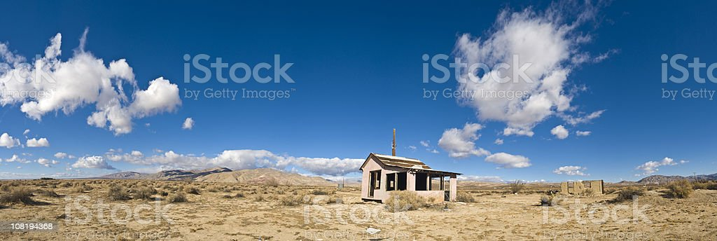 Abadoned House in Desert Against Blue Sky royalty-free stock photo