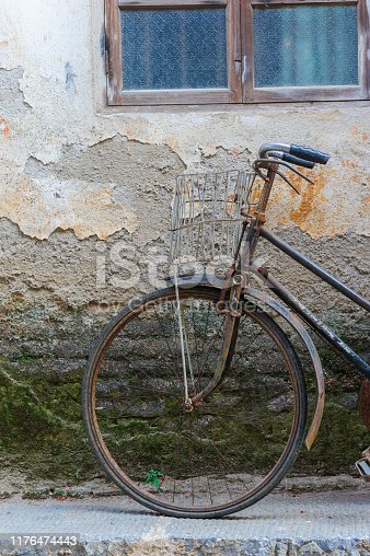 A abandon bicycle in the Chinese village street.