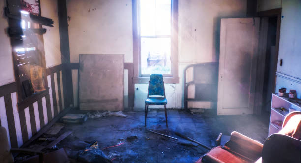 Abandon Room In Abused Old House Centered Chair With Bright Light Beams Drug Addiction Hideout stock photo