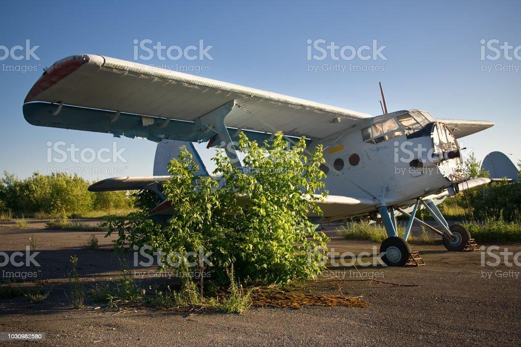 Abandoned airport. Old Soviet aircraft Antonov An-2 stock photo