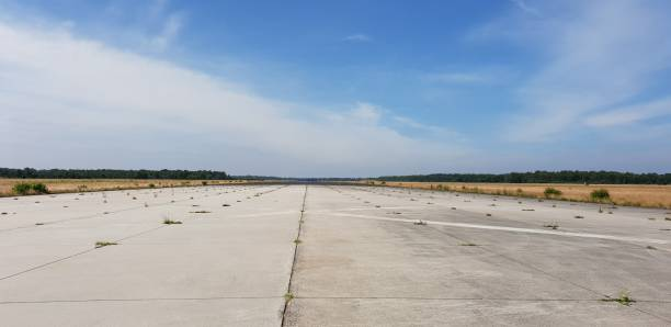 Abandoned airstrip An military airstrip, no longer in use, at a base near Vredepeel, The Netherlands airfield stock pictures, royalty-free photos & images