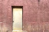 an abandoned alley back door od building