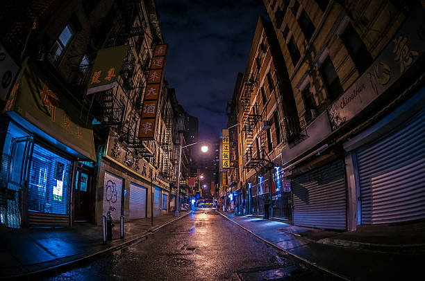 Abandoned Alley in Chinatown Dark, abandoned alley in New York City's Chinatown. alley stock pictures, royalty-free photos & images