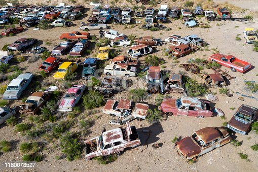 Wrecked, rusty, vintage, American classic cars on a junkyard, aerial view, Arizona, USA.