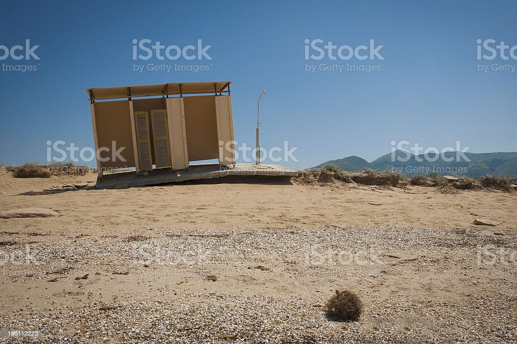 Abandoned and damaged changing cottage on beach royalty-free stock photo