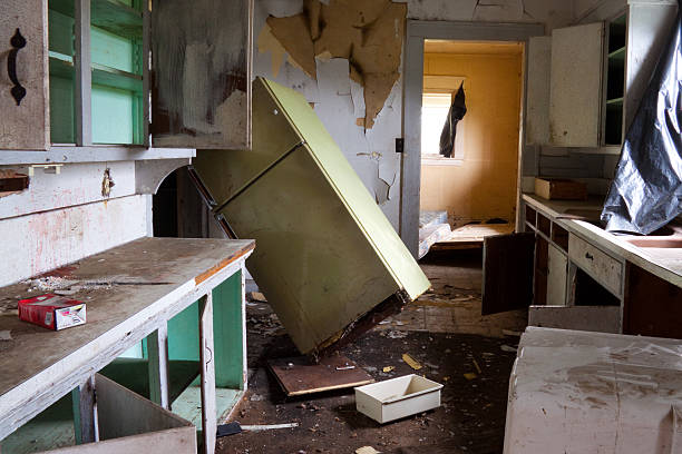 Abandoned and dilapidated house in horrible condition stock photo