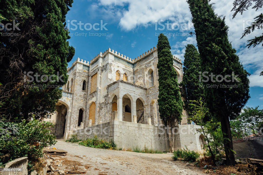 Abandoned and overgrown mansion in oriental style. Concept of Tale 1001 Arabian Nights. Villa Dream, Crimea stock photo