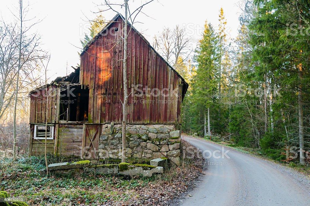 Abandoned barn beside road stock photo
