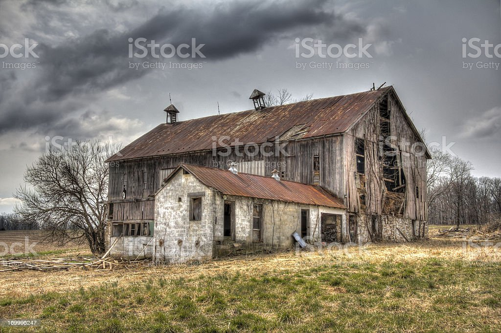 Abandoned Barn, Cloud Filled Sky  HDR stock photo