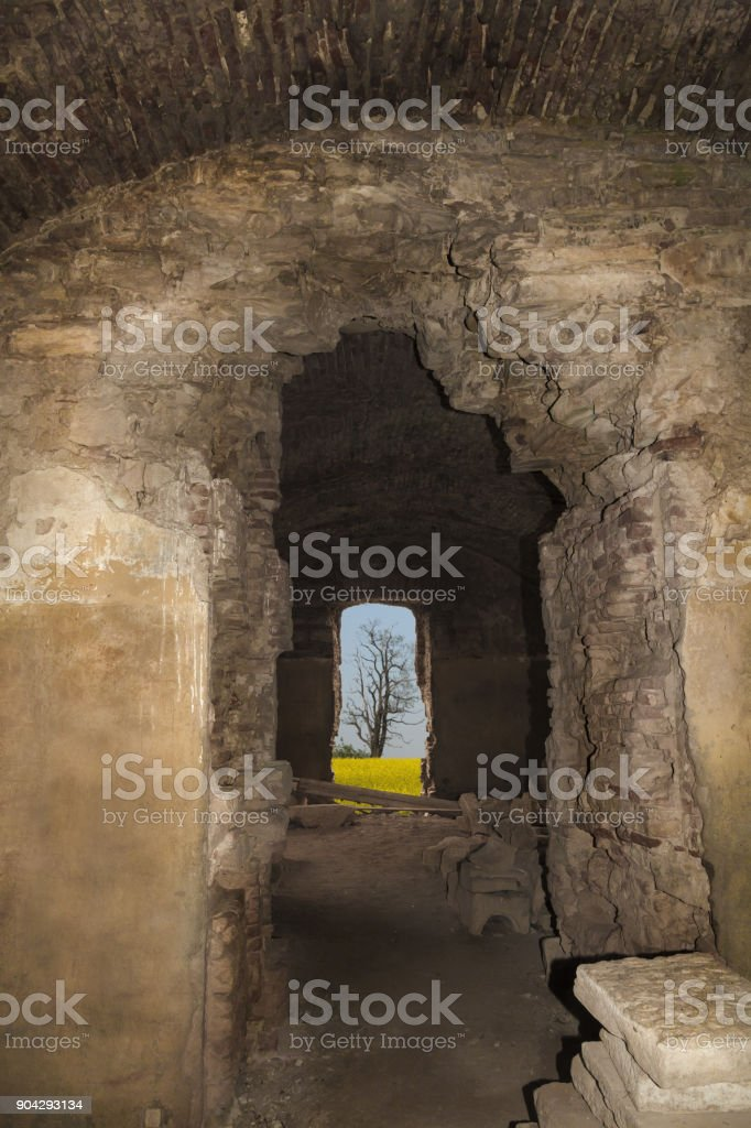 Abandoned basement of the tower of the ruins of a castle in transylvania, Boncida, Romania stock photo